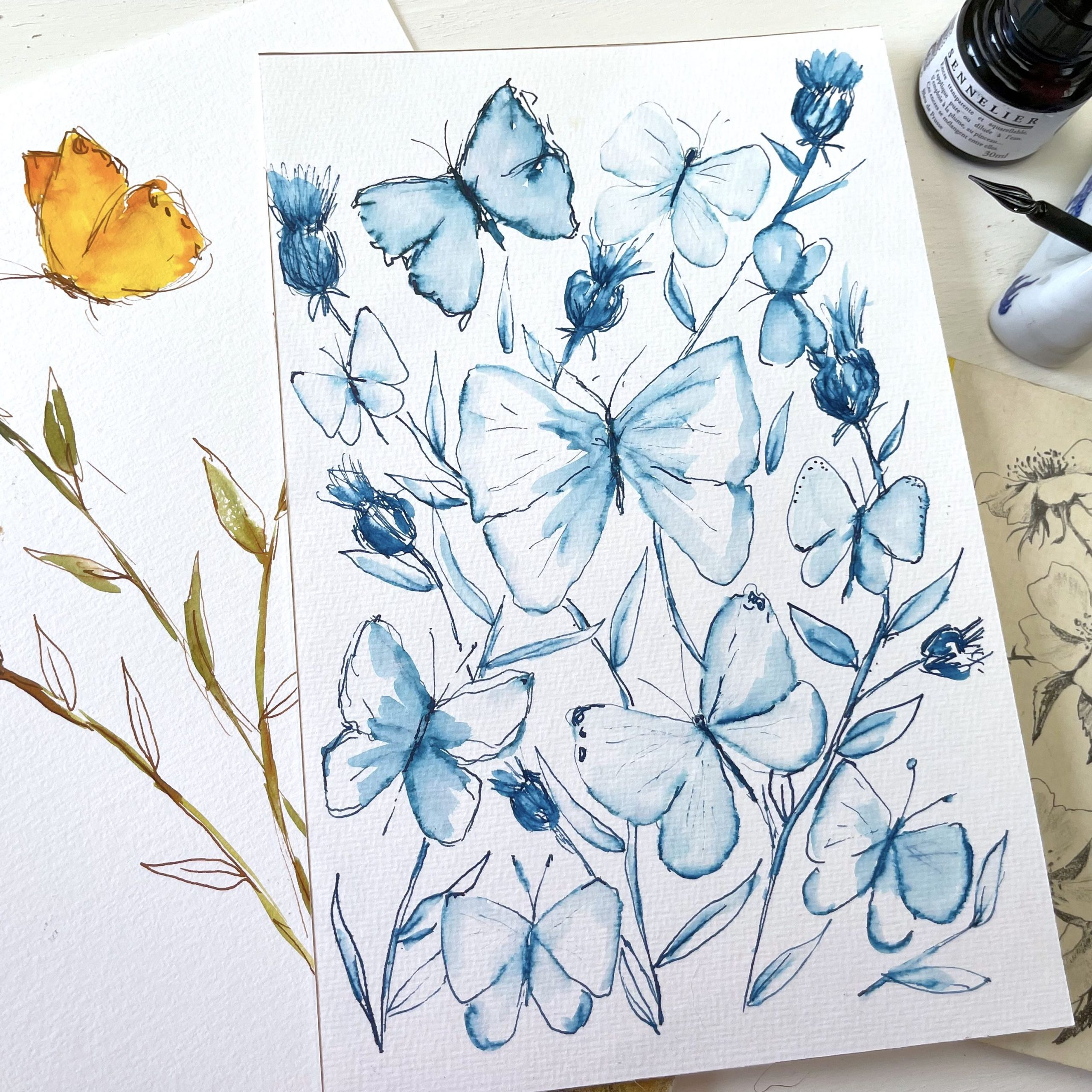 Watercolor painting of blue butterflies with sennelier ink and glass pen